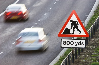 Roadworks sign over fast road