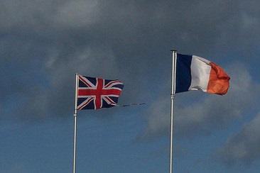 UK and French flags flying beside each other