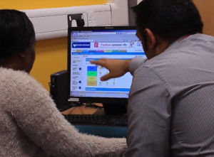 A Birmingham City Council housing support officer guides a new tenant through creation of a digital logbook.