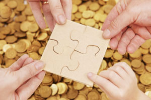 Jigsaw pieces over money