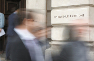 Blurred figures at HMRC entrance