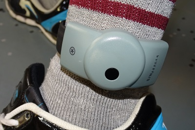 Electronic tag on ankle - with bright socks