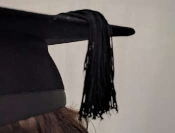 One side of mortar board with tassle