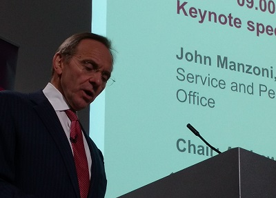 John Manzoni speaking at conference
