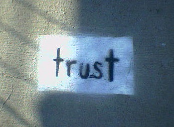 'trust' written on wall