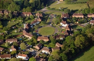 Aerial shot of houses around a green