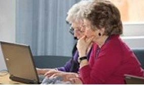 Two old ladies at laptop