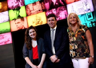 Andy Burnham flanked by two women at launch event