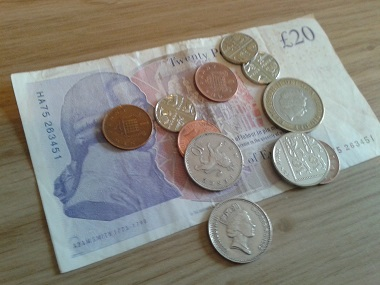Twenty pound note and coins
