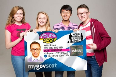 Young people holding giant Young Scot card
