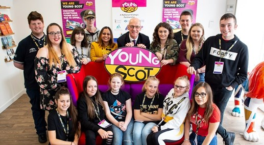 John Swinney with group of kids at launch event
