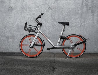 Mobike leaning against wall