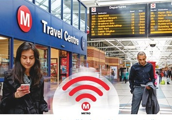 People using Wi-Fi at bus station