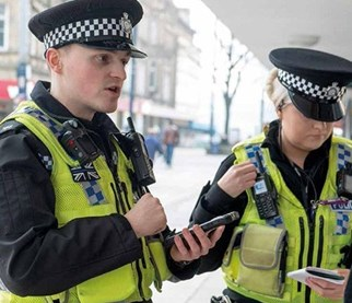 Police officers with mobile devices