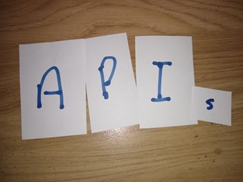 'API' on squares of paper