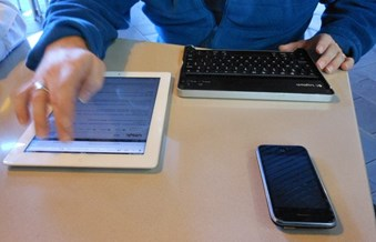 Tablet, laptop and phone on table