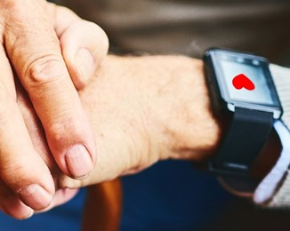 Smart watch on old person's hand
