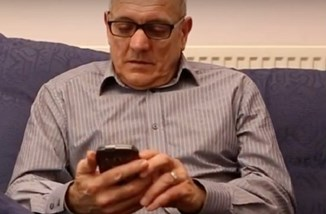 Old man on smartphone from University of Manchester.jpg