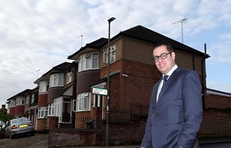 Councillor Dean Cohen in front of street light
