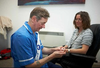 Woman receiving flu jab