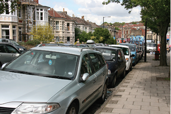 Parked cars in street