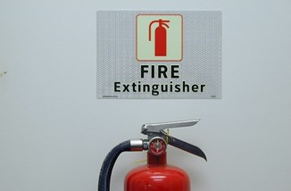 Fire extinguisher sign by MySafetySign.com CC BY 2.0.jpg