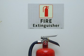 Top of fire extinguisher and sign