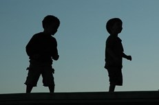 Two boys in silhouette
