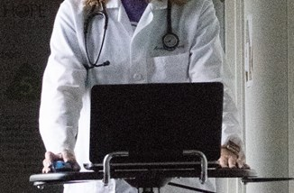 Doctor with laptop USDA public domain cropped.jpg
