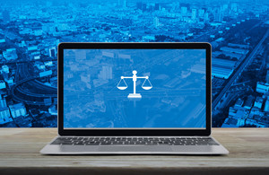 Justice scales on laptop